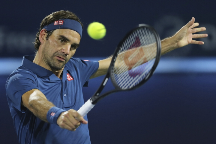 Roger Federer of Switzerland returns the ball to Fernando Verdasco of Spain during their match at the Dubai Duty Free Tennis Championship, in Dubai, United Arab Emirates, Wednesday, Feb. 27, 2019. (AP Photo/Kamran Jebreili)