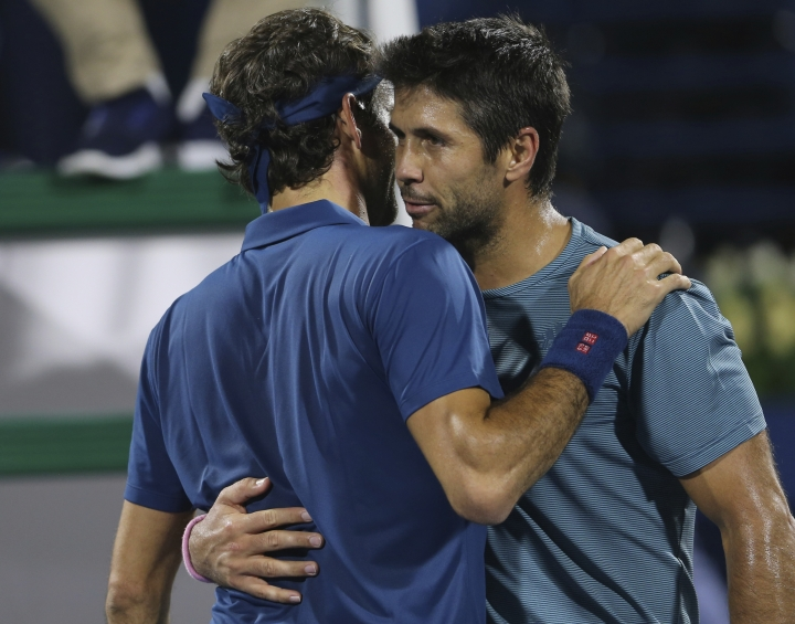 Fernando Verdasco of Spain hugs Roger Federer of Switzerland, left, after he was defeated by him in their match at the Dubai Duty Free Tennis Championship, in Dubai, United Arab Emirates, Wednesday, Feb. 27, 2019. (AP Photo/Kamran Jebreili)