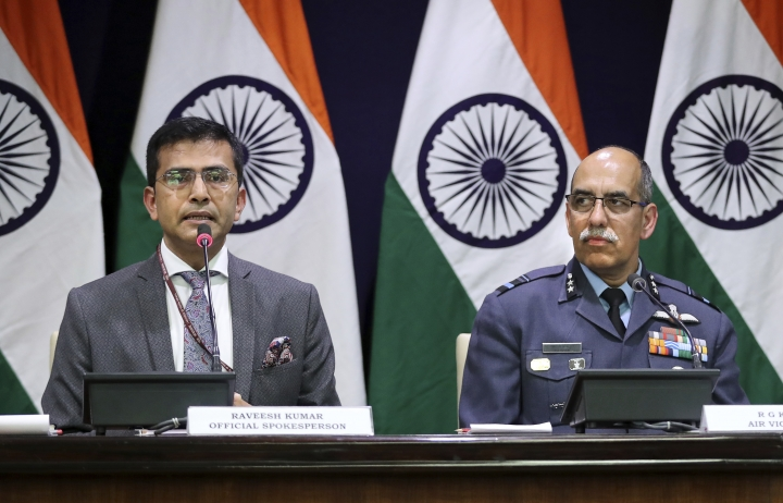 """Indian Foreign Ministry spokesperson Raveesh Kumar, left, with Indian Air Force Air Vice Marshal R.G.K. Kapoor gives a statement in New Delhi, India, Wednesday, Feb. 27, 2019. Pakistan's air force shot down two Indian warplanes after they crossed the boundary between the two nuclear-armed rivals in the disputed territory of Kashmir on Wednesday and captured two Indian pilots, one of whom was injured, a Pakistani military spokesman said. Kumar said one of its Mig-21 fighter aircraft was missing and that India was still """"ascertaining"""" whether its pilot was in Pakistan's custody. (AP Photo/Manish Swarup)"""