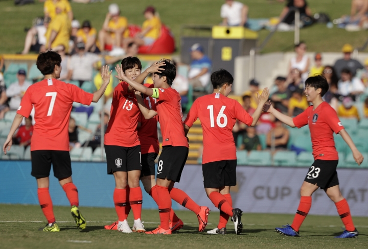 South Korea's Soyun Ji, center, is congratulated by teammates after scoring their 5th goal against Argentina during their Cup of Nations soccer game in Sydney, Thursday, Feb. 28, 2019. (AP Photo/Rick Rycroft)