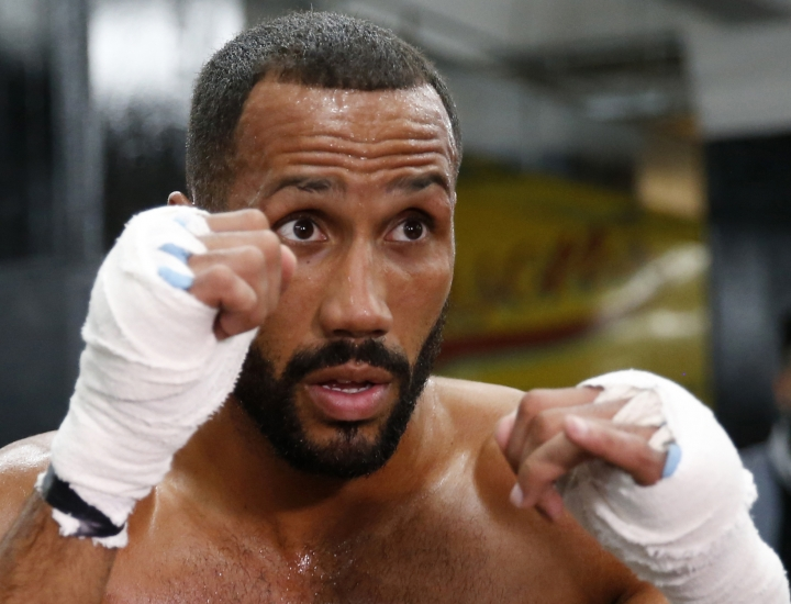 FILE - In this file photo dated Wednesday, Jan. 11, 2017, International Boxing Federation super-middleweight champion James DeGale of England works out in the ring at Gleason's gym, in the Brooklyn borough of New York. Two-time world boxing champion James DeGale has announced his retirement Thursday, Feb. 28, 2019, 10-years after his professional debut. (AP Photo/Kathy Willens, FILE)