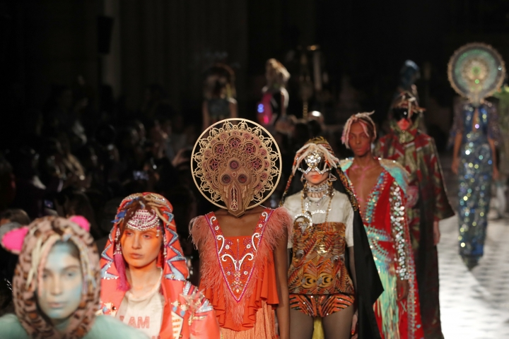 Models wear creations as part of the Manish Arora ready to wear Fall-Winter 2019-2020 collection, that was presented in Paris, Thursday, Feb. 28, 2019. (AP Photo/Christophe Ena)