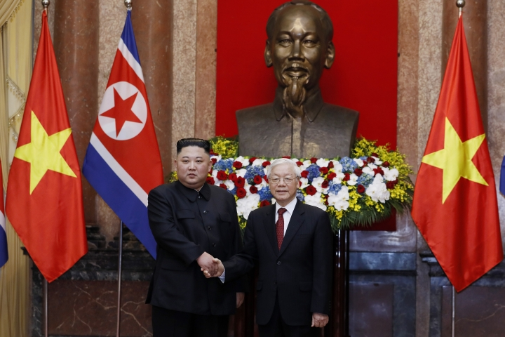 North Korea's leader Kim Jong-un, left, and Vietnam's President Nguyen Phu Trong shake hands at the President Palace in Hanoi, Vietnam, Friday March 1, 2019. Kim Jong-un is on a two-day official visit to Vietnam that will conclude Saturday.(Minh Hoang/Pool via AP)