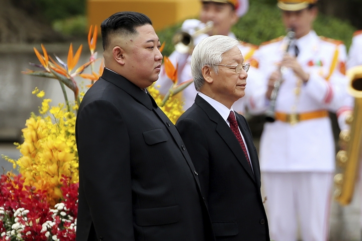 North Korea's leader Kim Jong Un, left, and Vietnam's President Nguyen Phu Trong review an honor guard during a welcome ceremony in Hanoi, Vietnam Friday, March 1, 2019. (Luong Thai Linh/Pool Photo via AP)