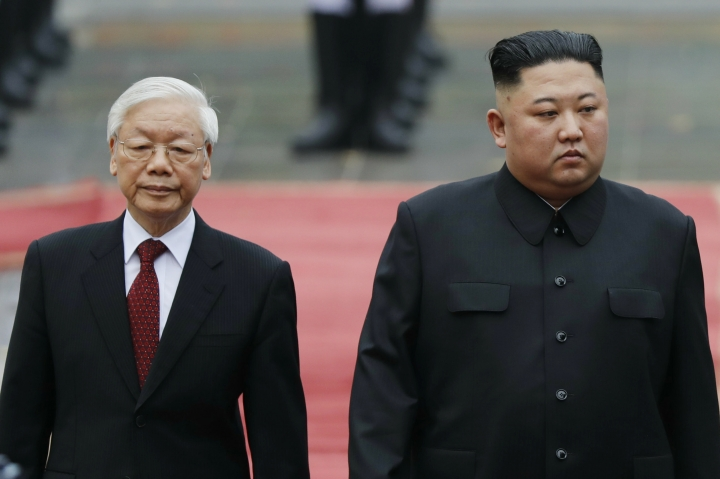 North Korea's leader Kim Jong Un, right, and Vietnam's President Nguyen Phu Trong attend a welcoming ceremony at the Presidential Palace, Friday, March 1, 2019, in Hanoi, Vietnam. (Kham/Pool Photo via AP)