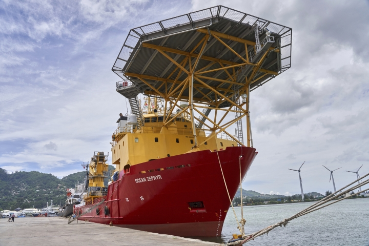 The research vessel Ocean Zephyr docked in Victoria, the Seychelles, on Friday March 1, 2019, where it will spend several days loading and testing equipment ahead of a weeks-long expedition to explore the depths of the Indian Ocean. The Ocean Zephyr is the mothership of the British-based Nekton Mission for scientists to document the impact of global warming in the unexplored frontier of the Indian Ocean that could affect billions of people in the surrounding region over the coming decades. (AP Photo/Steve Barker)