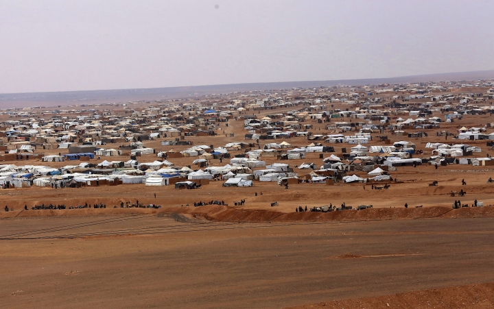 FILE - This file picture taken Tuesday, Feb. 14, 2017, shows an aerial view of the informal Rukban camp, between the Jordan and Syria borders. The Russian military says the Syrian government is sending convoys to evacuate a refugee camp in southern Syria where tens of thousands suffer from lack of food and medical supplies. Col. Gen. Mikhail Mizintsev said the Syrian convoys are heading on Friday, March 1, 2019 to the Rukban camp and urged the U.S. military in the area to secure its safe passage. (AP Photo/ Raad Adayleh, File)