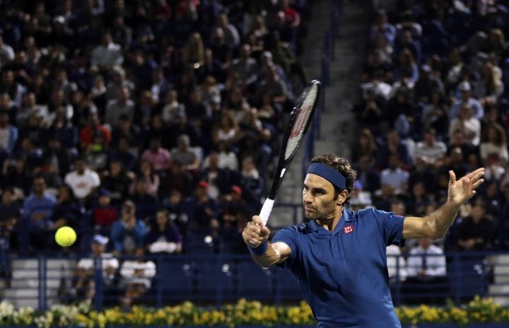 Roger Federer of Switzerland returns the ball to Marton Fucsovics of Hungry during their match at the Dubai Duty Free Tennis Championship, in Dubai, United Arab Emirates, Thursday, Feb. 28, 2019. (AP Photo/Kamran Jebreili)