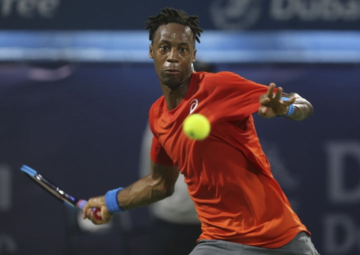 Gael Monfils of France returns the ball to Stefanos Tsitsipas of Greece during their semi final match at the Dubai Duty Free Tennis Championship, in Dubai, United Arab Emirates, Friday, March 1, 2019. (AP Photo/Kamran Jebreili)
