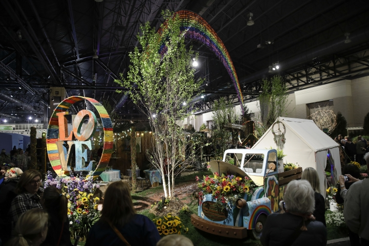 """Visitors view an instillation during a preview of the """"Flower Power"""" themed Philadelphia Flower Show at the at the Pennsylvania Convention Center in Philadelphia, Friday, March 1, 2019. (AP Photo/Matt Rourke)"""