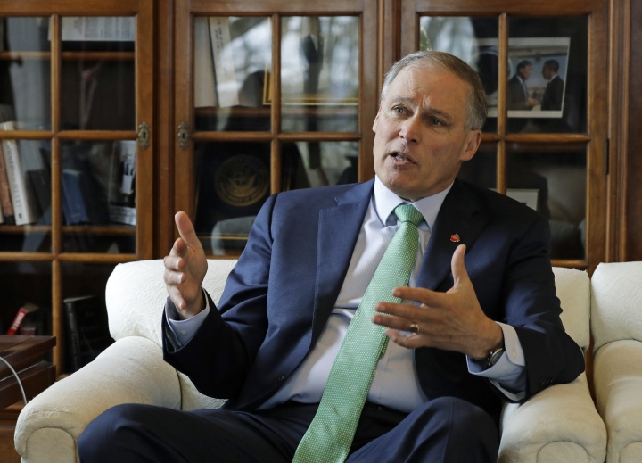In this photo taken Jan. 24, 2019, Washington Gov. Jay Inslee takes part in an Associated Press interview in his office at the Capitol in Olympia, Wash. Inslee is adding his name to the growing 2020 Democratic presidential field. The 68-year-old is announcing his bid Friday, March 1, 2019, in Seattle after recent travels to two of the four early-nominating states. (AP Photo/Ted S. Warren)