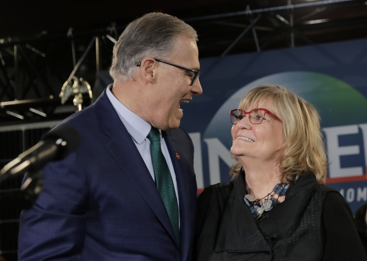 Washington Gov. Jay Inslee, left, greets his wife, Trudi Inslee, right, Friday, March 1, 2019, following a campaign event at A&R Solar in Seattle. Inslee announced that he will seek the 2020 Democratic presidential nomination, mixing calls for combating climate change and highlights of his liberal record with an aggressive critique of President Donald Trump. (AP Photo/Ted S. Warren)