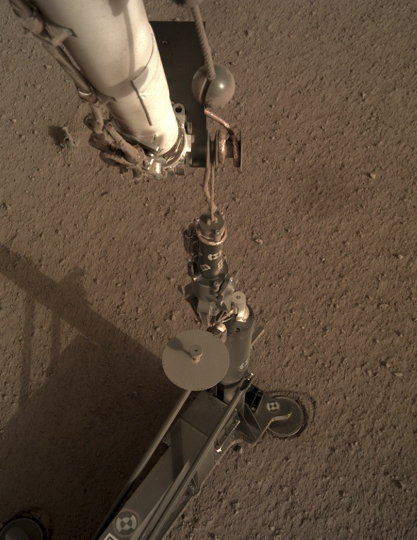 This photo provided by NASA/JPL-Caltech shows an image acquired by NASA's InSight Mars lander using its robotic arm-mounted, Instrument Deployment Camera (IDC). The image was acquired on March 1, 2019, Sol 92 where the local mean solar time for the image exposures was 16:53:31.055 PM. Scientists say NASA's newest Mars lander has started digging into the red planet, but has hit a few snags. (NASA/JPL-Caltech via AP)