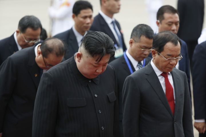 North Korean leader Kim Jong Un, front left, attends a wreath laying ceremony at Ho Chi Minh Mausoleum in Hanoi, Vietnam Saturday, March 2, 2019. Kim paid his respects Saturday to Vietnamese revolutionary leader Ho Chi Minh, whose embalmed body is on permanent display, just like Kim's own father and grandfather in North Korea. (Jorge Silva/Pool Photo via AP)