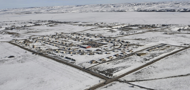 """FILE - In this Feb. 13, 2017 file photo shows the town of Cannon Ball, N.D., on the Standing Rock Sioux Indian Reservation. The Native American tribe leading the fight against the Dakota Access oil pipeline said Thursday, Feb. 28, 2019, an Army Corps of Engineers document shows the agency concluded the pipeline wouldn't unfairly affect tribes before it consulted them. The Standing Rock Sioux officials say the document bolsters the tribe's claim that the Corps disregarded a federal judge's order to seriously review the pipeline's potential impact on the Standing Rock Sioux and three other Dakotas-based tribes and to not treat the study as a """"bureaucratic formality."""" (Tom Stromme/The Bismarck Tribune via AP, File)"""