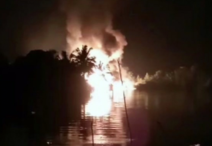 In this image made from video on Friday, March 1, 2019, fire is seen from a pipeline explosion in Nembe, Nigeria. More than 50 people are missing after a leaking oil pipeline exploded and caused a stampede in southern Nigeria, a local official said Saturday. The blast early Friday caused massive oil spillage in the Nembe kingdom in Bayelsa state, the Nembe Chiefs Council spokesman, Chief Nengi James-Eriworio, told The Associated Press. (AP Photo)
