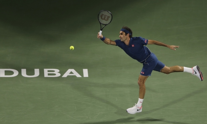 Roger Federer of Switzerland returns the ball to Stefanos Tsitsipas of Greece during their final match at the Dubai Duty Free Tennis Championship, in Dubai, United Arab Emirates, Saturday, March 2, 2019. (AP Photo/Kamran Jebreili)