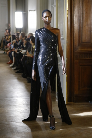 A model wears a creation as part of the Elie Saab ready to wear Fall-Winter 2019-2020 collection, that was presented in Paris, Saturday, March 2, 2019. (AP Photo/Michel Euler)