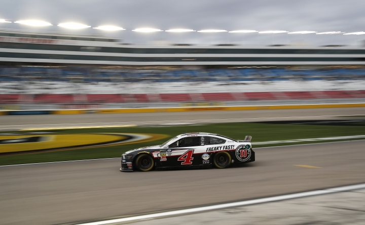 Kevin Harvick (4) drives down pit lane during qualifying for a NASCAR Cup Series auto race at the Las Vegas Motor Speedway, Friday, March 1, 2019, in Las Vegas. (AP Photo/John Locher)