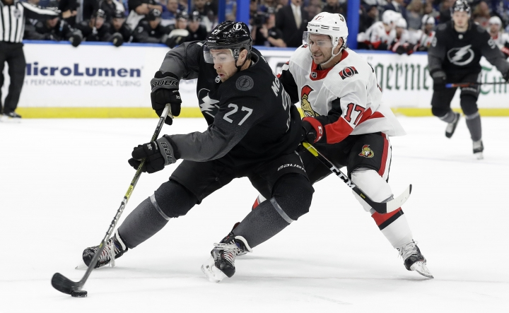 Tampa Bay Lightning defenseman Ryan McDonagh (27) cuts in front of Ottawa Senators left wing Brian Gibbons (17) during the first period of an NHL hockey game Saturday, March 2, 2019, in Tampa, Fla. (AP Photo/Chris O'Meara)