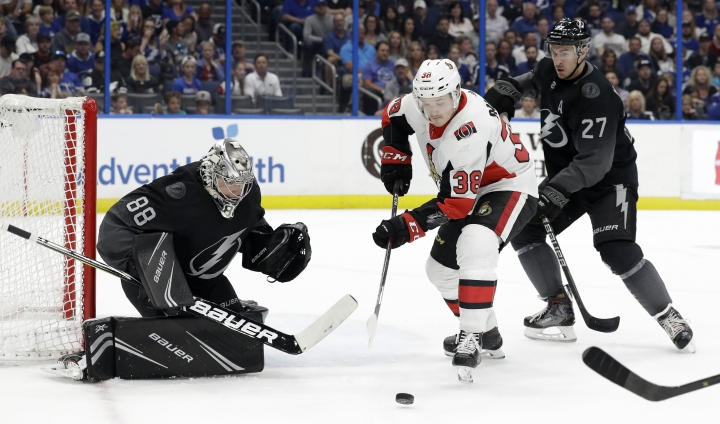 Ottawa Senators left wing Rudolfs Balcers (38) picks up a rebound after Tampa Bay Lightning goaltender Andrei Vasilevskiy (88) made a save during the first period of an NHL hockey game Saturday, March 2, 2019, in Tampa, Fla. Defending for Tampa Bay is Ryan McDonagh (27). (AP Photo/Chris O'Meara)