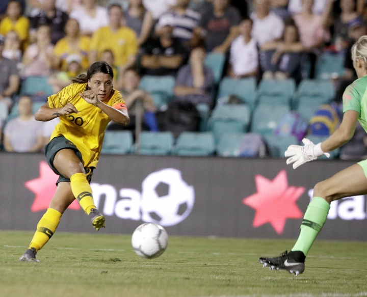 Australia's Samantha Kerr, left, has a shot on New Zealand's goalkeeper Erin Nayler during their Cup of Nations soccer game in Sydney, Thursday, Feb. 28, 2019. (AP Photo/Rick Rycroft)