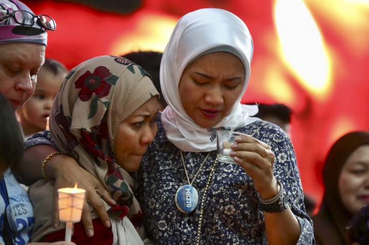 Norazlinda Ayub, left, and Intan Maizura Othaman, wife of an air crew member of Malaysia Airlines Flight 370, embrace each other during the Day of Remembrance for MH370 event in Kuala Lumpur, Malaysia, Sunday, March 3, 2019. Five years ago, Flight MH370, a Boeing 777, had gone missing the day before while over the South China Sea with 239 people on board. (AP Photo/Annice Lyn)