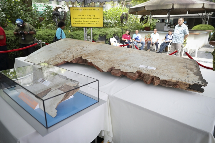 Debris from the missing Malaysia Airlines Flight MH370 is displayed during a Day of Remembrance for MH370 event in Kuala Lumpur, Malaysia, Sunday, March 3, 2019. Five years ago, Flight MH370, a Boeing 777, had gone missing the day before while over the South China Sea with 239 people on board. (AP Photo/Vincent Thian)