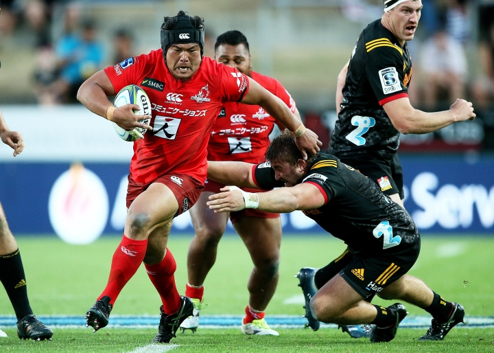 Sunwolves prop Hiroshi Yamashita, left, runs during the Super Rugby match between the Sunwolves and the Chiefs in Hamilton, New Zealand, Saturday, March 2, 2019. (AP Photo/Bruce Lim)