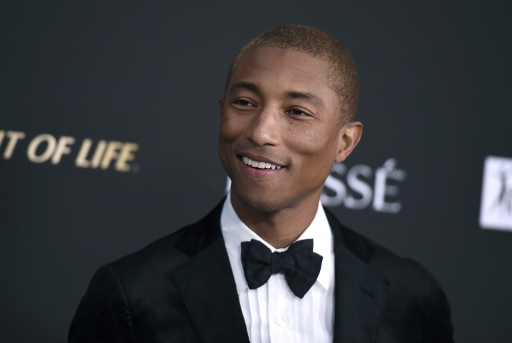 "FILE - In this Oct. 11, 2018 file photo, Pharrell Williams arrives at the City of Hope Gala at the Barker Hangar in Santa Monica, Calif. Pharrell is heading home to Virginia Beach to launch a new music and culture festival. The Grammy-winning superstar announced Monday, March 4, 2019, SOMETHING IN THE WATER, a multi-day event he's calling a ""cultural experience"" that will debut April 26-28. He will perform on a stage set on the beach; other performers include Missy Elliott, Travis Scott, Migos, Dave Matthews Band, Janelle Monae, SZA and Diplo. (Photo by Jordan Strauss/Invision/AP, File)"