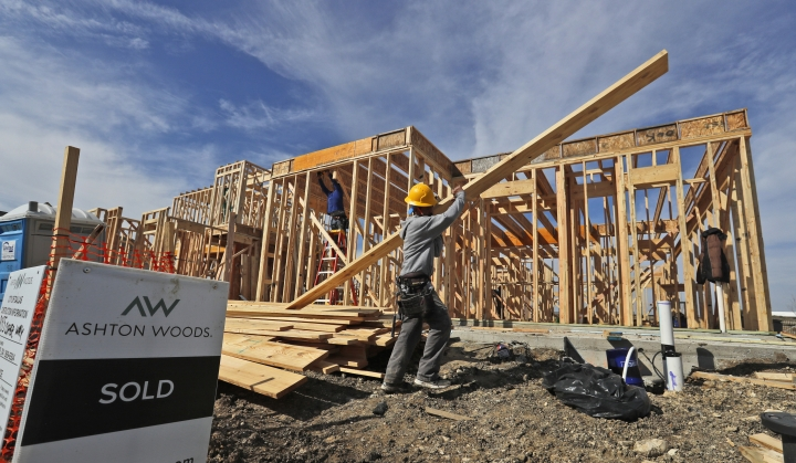 FILE - In this Feb. 20, 2019 file photo a construction crew works on an already sold new home in north Dallas. U.S. construction spending edged down 0.6 percent in December with declines in residential construction and government projects. Even with the December setback, construction spending for all of 2018 rose to a new record although the annual increase was the smallest in seven years. (AP Photo/LM Otero, File)