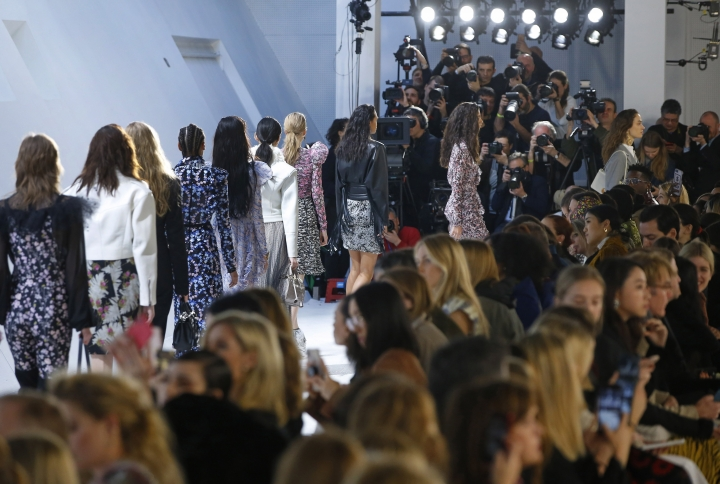 Models wear creations as part of the Giambattista Valli ready-to-wear Fall-Winter 2019-2020 fashion collection, that was presented in Paris, Monday, March 4, 2019. (AP Photo/Michel Euler)