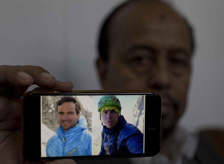 Karrar Haidri, secretary of the Alpine Club of Pakistan shows pictures of two missing climbers, Briton Tom Ballard, right, and Italian Daniele Nardi in Islamabad, Pakistan, Monday, March 4, 2019. Pakistani military helicopters took off Monday with four Spanish rescuers to search for a missing pair of European climbers on Nanga Parbat, the world's ninth highest mountain. (AP Photo/B.K. Bangash)