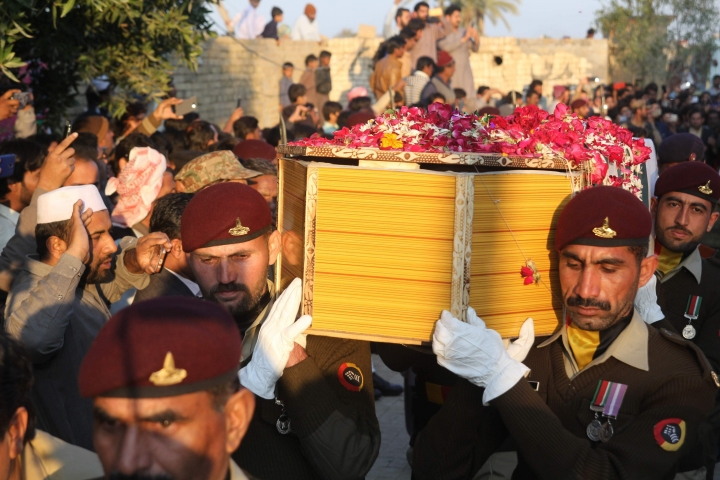 Pakistani soldiers carry a coffin of Pakistani soldier Khuram Ali who reportedly lost his life during heavy shelling from Indian troops at the Line of Control in Pakistani Kashmir, during his funeral in Dera Ghazi Khan in Pakistan, Monday, March 4, 2019. A key train service with neighboring India resumed and schools in Pakistani Kashmir opened Monday in another sign of easing tensions between the two nuclear-armed rivals since a major escalation last week over the disputed Kashmir region. (AP Photo/Asim Tanveer)