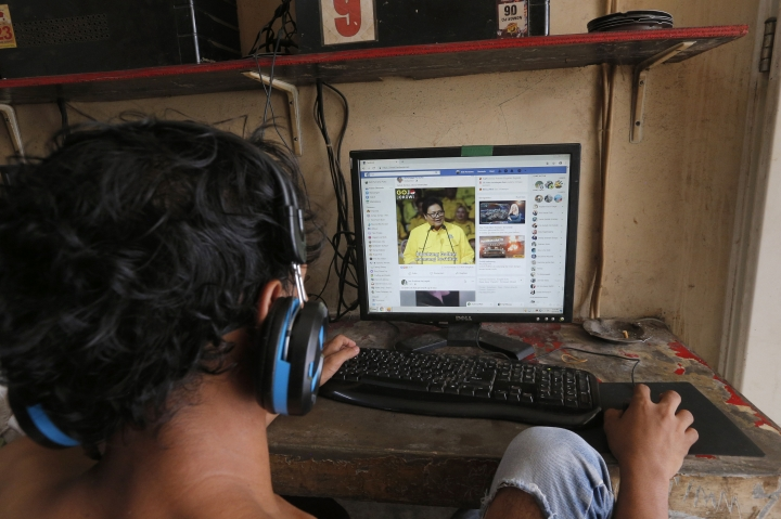 An Indonesian youth browses his Facebook page at an Internet cafe in Jakarta, Indonesia Tuesday, March 5, 2019. Facebook says it will not allow foreign-funded advertisements for an upcoming presidential election in Indonesia, the world's third-largest democracy, hoping to allay concerns that its platform is being used to manipulate voting behavior. (AP Photo/Tatan Syuflana)