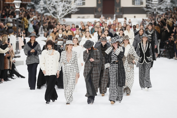Model Cara Delevingne, second from left, looks as models wipe tears from their eyes as they wear creations as part of the Chanel ready to wear Fall-Winter 2019-2020 collection, that was presented in Paris, Tuesday, March 5, 2019. (AP Photo/Francois Mori)