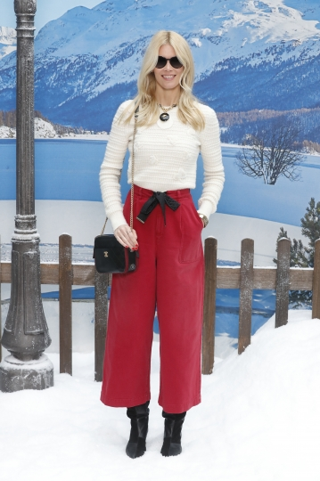 Model Claudia Schiffer poses for photographers upon arrival at the Chanel ready to wear Fall-Winter 2019-2020 collection, that was presented in Paris, Tuesday, March 5, 2019. (AP Photo/Thibault Camus)