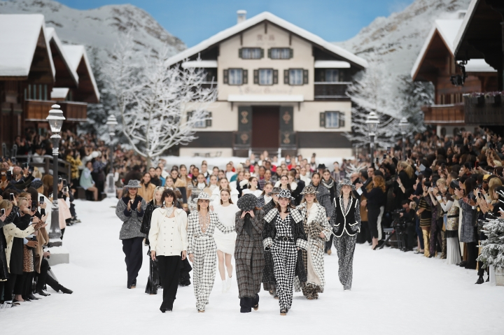 Model Cara Delevingne, second from left, comforts a model as they wear creations as part of the Chanel ready to wear Fall-Winter 2019-2020 collection, that was presented in Paris, Tuesday, March 5, 2019. (AP Photo/Francois Mori)
