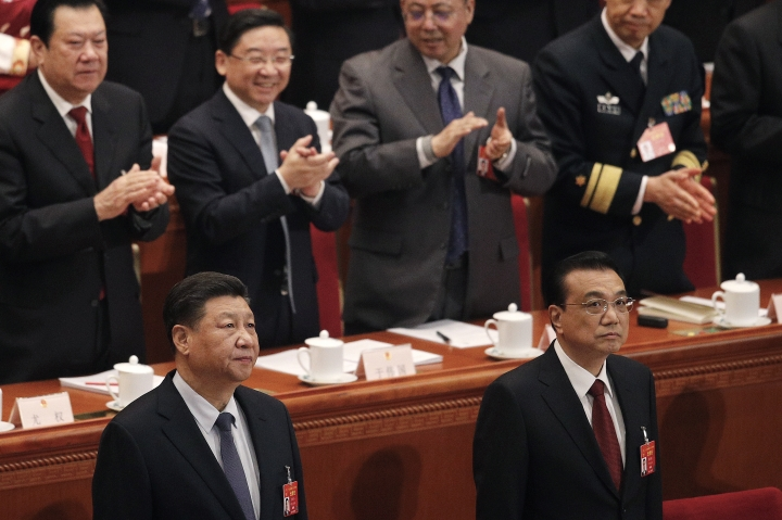 Chinese President Xi Jinping, foreground left, and Chinese Premier Li Keqiang, foreground right, look as they arrive at the opening session of the China's National People's Congress at the Great Hall of the People in Beijing, Tuesday, March 5, 2019. (AP Photo/Andy Wong)