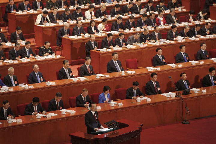 Chinese Premier Li Keqiang delivers the work reports at the opening session of the China's National People's Congress at the Great Hall of the People in Beijing, Tuesday, March 5, 2019. (AP Photo/Andy Wong)