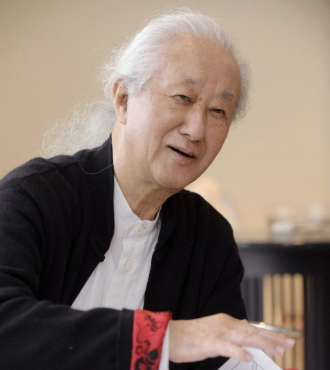 In this photo taken in 2012, architect Arata Isozaki is interviewed. Isozaki, credited with bringing together the East and West in his innovative designs, has been awarded this year's Pritzker Architecture Prize, known internationally as the highest honor in the field. The 2019 prize was announced Tuesday, March 5, 2019. (Kyodo News via AP)