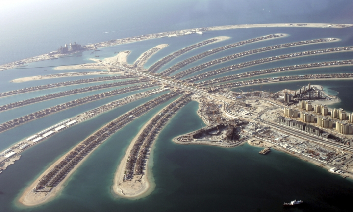 FILE - In this May 3, 2007 file photo, the Nakheel-built Palm Jumeirah archipelago is seen from a helicopter, in Dubai, United Arab Emirates. On Wednesday, March 6, 2019, property developer Nakheel, behind eye-popping projects like Dubai's palm-shaped islands, announced recorded profits of $1.2 billion for 2018. That's down from profits of $1.5 billion in 2017. (AP Photo/Kamran Jebreili, File)
