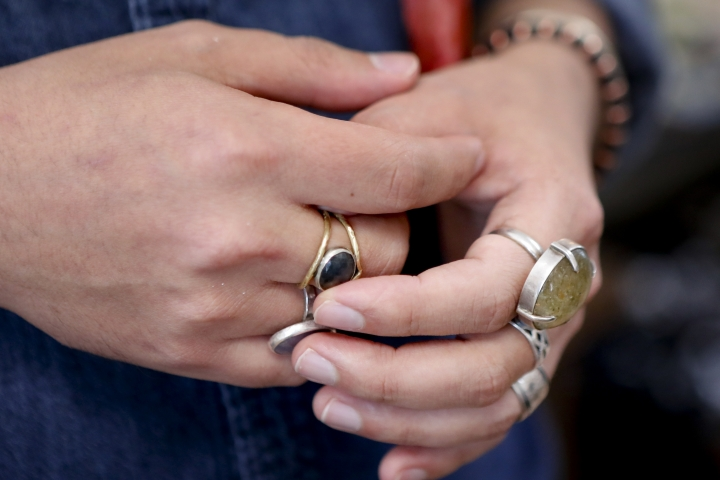 In this Thursday, Feb. 28, 2019, photo co-owner Andrew Thornton touches one of his rings as he talks about his jewelry and art store, Allegory Gallery, in the small town of Ligonier, Pa. Thornton says social media is a resource they use to stay on top of trends by connecting with their customers. (AP Photo/Keith Srakocic)
