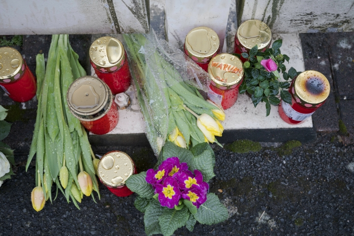 Flowers are set at a house of a doctor, who died in an explosion by a booby trap in Enkenbach-Alsenborn, Germany, Tuesday, March 5, 2019. A gardener, who was found also dead, is suspected to have set the booby trap. (Oliver Dietze/dpa via AP)