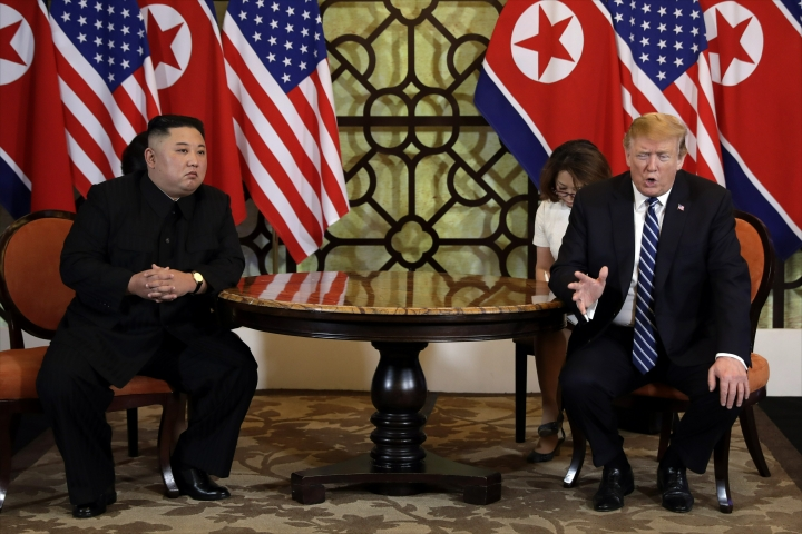 FILE - In this Feb. 28, 2019, file photo, U.S. President Donald Trump, right, meets North Korean leader Kim Jong Un in Hanoi, Vietnam. North Korea is reportedly restoring facilities at its long-range rocket launch site that it had dismantled as part of disarmament steps last year. The development came after a high-stakes nuclear summit between Kim and Trump ended without any agreement. (AP Photo/Evan Vucci, File)