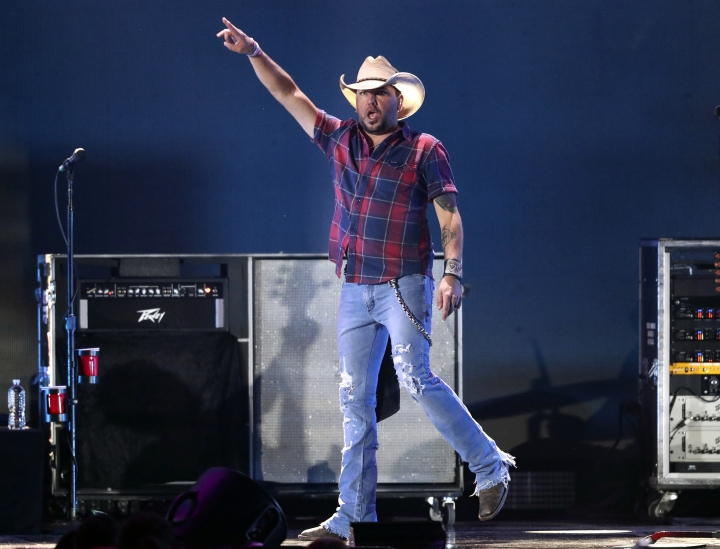 FILE - In this Sept. 21, 2018 file photo, Jason Aldean performs at the 2018 iHeartRadio Music Festival in Las Vegas. Reigning entertainer of the year Aldean will receive the artist of the decade award at this year's Academy of Country Music Awards in April 2019. The ACM announced Wednesday, March 6, 2019, that Aldean will join only five other honorees that have received the award since 1969, including Marty Robbins, Loretta Lynn, Alabama, Garth Brooks and George Strait. (Photo by John Salangsang/Invision/AP, File)
