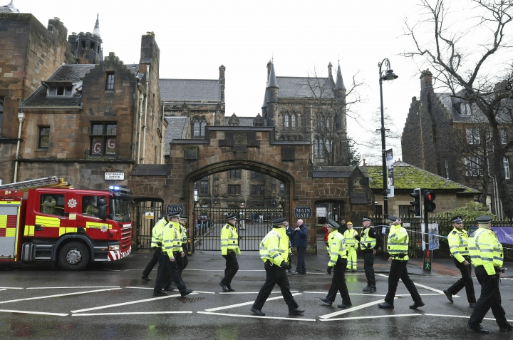 Police and fire services outside the University of Glasgow after the building was evacuated when a suspect package was found in the mailroom, in Glasgow, Scotland, Wednesday March 6, 2019. Buildings at the University of Glasgow were evacuated Wednesday as police examined a suspicious package found in the mailroom, a day after three London transport hubs received letter bombs. (Andrew Milligan/PA via AP)