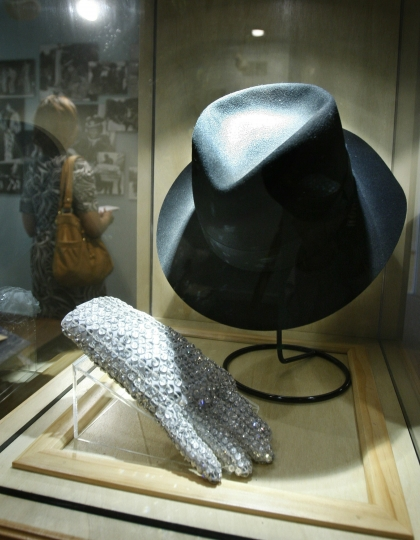 FILE - In this June 21, 2010 file photo, a hat and sequined glove once belonging to Michael Jackson is displayed at the Motown Historical Museum at Hitsville U.S.A. in Detroit. Some fans may be removing Michael Jackson's music from their playlists after a new documentary rekindles allegations of child sexual abuse, but at least two music museums in Detroit and Tennessee aren't scrubbing the King of Pop from their exhibits. (AP Photo/Carlos Osorio)