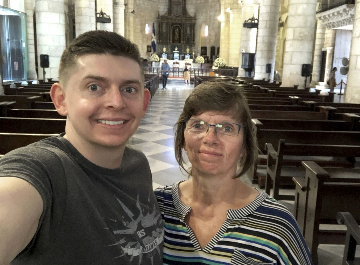 In this June 2018, selfie provided by Sherry Weddle, her son and journalist Cody Weddle and herself pose for a photo during a vacation in Santo Domingo, the Dominican Republic. Cody was seized by security forces at his apartment in Caracas, Venezuela, early Wednesday, March 6,2019, amid Venezuela's escalating political turmoil, lawyers and press freedom groups said. (Courtesy Sherry Weddle via AP)