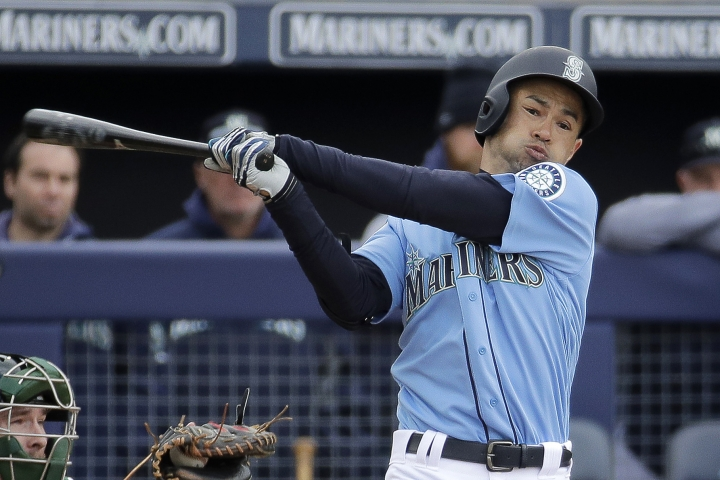 FILE - In this Friday, Feb. 22, 2019 file photo, Seattle Mariners' Ichiro Suzuki bats during the third inning of a spring training baseball game against the Oakland Athletics in Peoria, Ariz. Jerry Dipoto's first introduction to the world of Ichiro Suzuki was only a small taste compared to what the Seattle Mariners are about to experience when they open the season in Tokyo with a pair of games against the Oakland Athletics. The most decorated player ever to export his talents from Japan to the major leagues is returning home for what could be a farewell to his Hall of Fame career on both sides of the Pacific. His teammates can't wait. (AP Photo/Charlie Riedel, File)